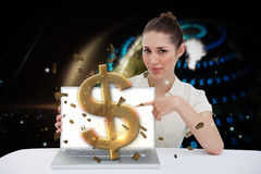 Businesswoman pointing to her laptop showing dollar sign Royalty Free Stock Photo