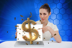 Businesswoman pointing to her laptop showing dollar sign Royalty Free Stock Image