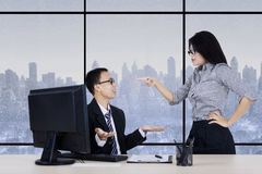 Businesswoman pointing to her subordinate Stock Photography