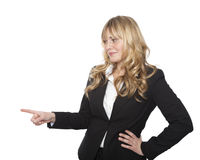 Businesswoman pointing to the left with a smile Stock Photos