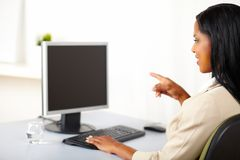 Businesswoman pointing to a monitor Stock Photography