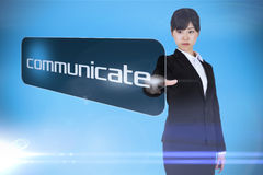 Businesswoman pointing to word communicate Royalty Free Stock Photo