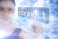 Businesswoman pointing to word connect Stock Photography