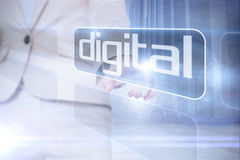 Businesswoman pointing to word digital Stock Images