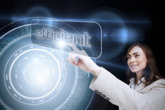 Businesswoman pointing to word efficient Stock Images
