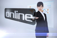 Businesswoman pointing to word online Stock Photos