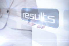Businesswoman pointing to word results Stock Images
