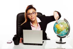 Businesswoman pointing to a world globe Royalty Free Stock Images