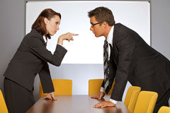 Businesswoman pointing towards businessman in office Royalty Free Stock Image