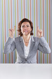 Businesswoman pointing up Royalty Free Stock Image