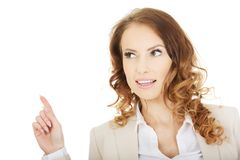 Businesswoman pointing up. stock photo