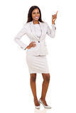 Businesswoman pointing up Stock Photo