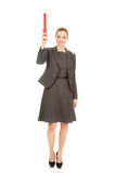 Businesswoman pointing up with pencil. Royalty Free Stock Photos