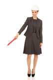 Businesswoman pointing up with pencil. Royalty Free Stock Images
