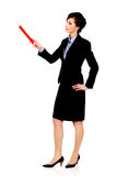 Businesswoman pointing up with pencil. Stock Image