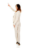 Businesswoman pointing up. Royalty Free Stock Photo