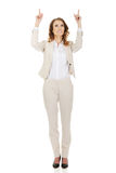 Businesswoman pointing up. Stock Image