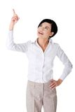 Businesswoman pointing up to the corner Royalty Free Stock Images