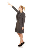 Businesswoman pointing up. Young beautiful businesswoman pointing up Royalty Free Stock Images