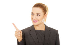Businesswoman pointing up. Young beautiful businesswoman pointing up Royalty Free Stock Image