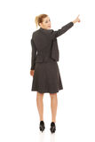 Businesswoman pointing up. Young beautiful businesswoman pointing up Stock Images
