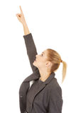 Businesswoman pointing up. Young beautiful businesswoman pointing up Stock Photography
