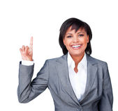 Businesswoman pointing upwards Stock Photos