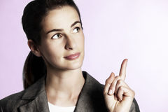 Businesswoman pointing upwards. Stock Photo