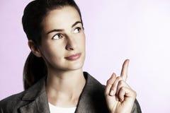 Free Businesswoman Pointing Upwards. Stock Photo - 14647680