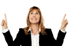 Businesswoman pointing upwards Stock Photo