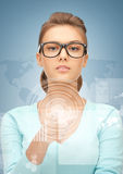 Businesswoman pointing at virtual screen Stock Images