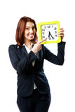 Businesswoman pointing on a wall clock Stock Photos