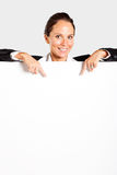 Businesswoman pointing at white board Royalty Free Stock Images