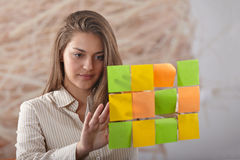 Businesswoman pointing on whiteboard Royalty Free Stock Photography