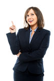 Businesswoman pointing and winking Royalty Free Stock Photos