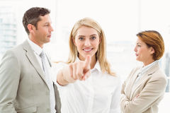 Businesswoman pointing at you with colleagues in office Royalty Free Stock Images