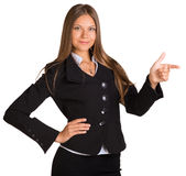 Businesswoman points finger toward Royalty Free Stock Photos