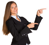 Businesswoman points fingers toward Royalty Free Stock Image