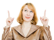 Businesswoman points his finger upward. Stock Photo