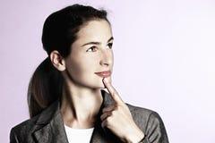 Businesswoman pondering Stock Photos