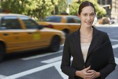 Businesswoman With Portfolio On Street Stock Photography