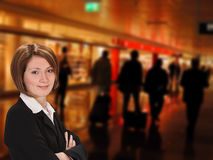 Businesswoman portrait. Portrait of a young businesswoman in a commercial area of an airport Royalty Free Stock Image
