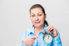 Businesswoman portrait with an alarm clock in hands. At the office Royalty Free Stock Images