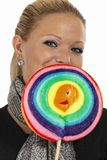Businesswoman posing with candy lollypop Royalty Free Stock Photography