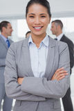Businesswoman posing while colleagues talking together Stock Images