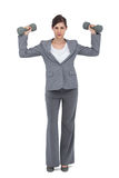 Businesswoman posing with dumbbells Royalty Free Stock Photo