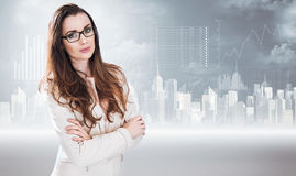 Businesswoman posing on a graph background. Businesswoman posing on a diagram background Stock Photos