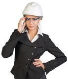 Businesswoman posing in hard hat and protective Stock Images