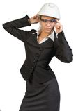 Businesswoman posing in hard hat and protective Royalty Free Stock Image