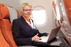 Businesswoman posing with laptop Royalty Free Stock Image